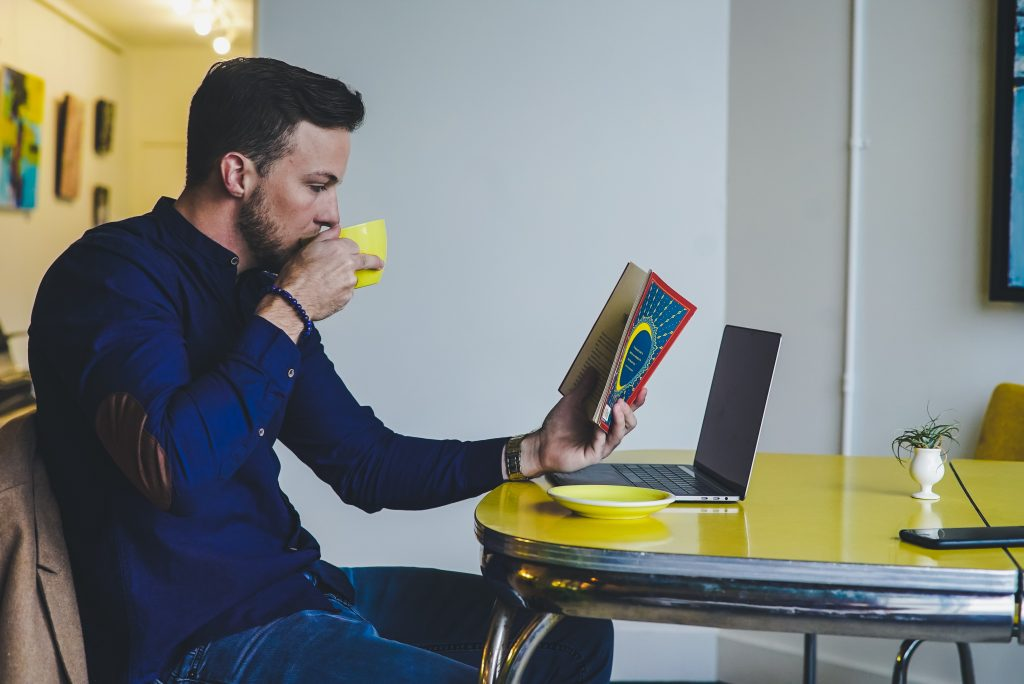 man focusing on work and a book representing using cannabis for add